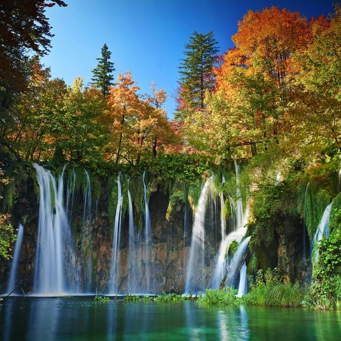 Plitvice Lakes National Park. This unusual natural phenomenon consists of forest-fringed waterfalls and turquoise lakes.
